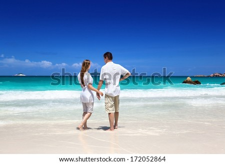 man and woman romantic couple on tropical beach - stock photo
