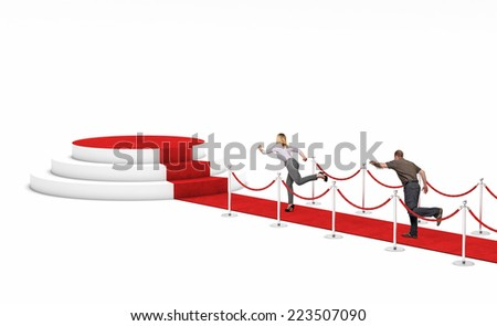 man and woman run on red carpet - stock photo