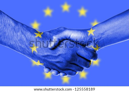 Man and woman shaking hands, wrapped in flag pattern, European Union