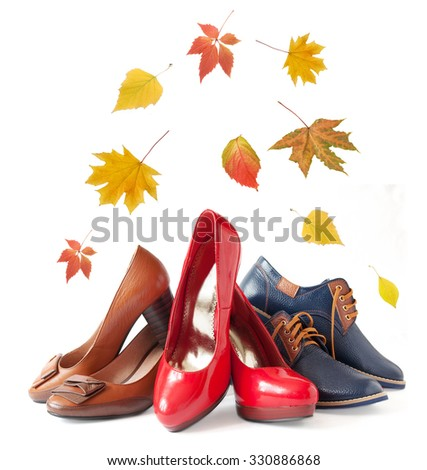 Man and woman shoes isolated on white background with autumn leaves. Man and woman shoes collection sales concept - stock photo