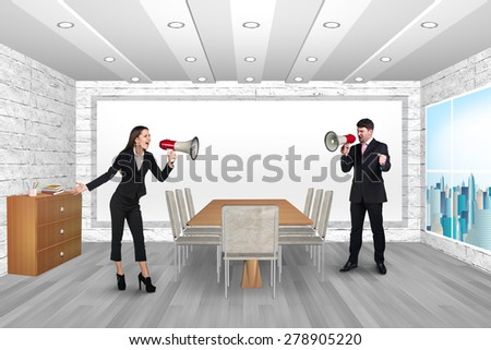 Man and woman shouting in megaphones. Office - stock photo