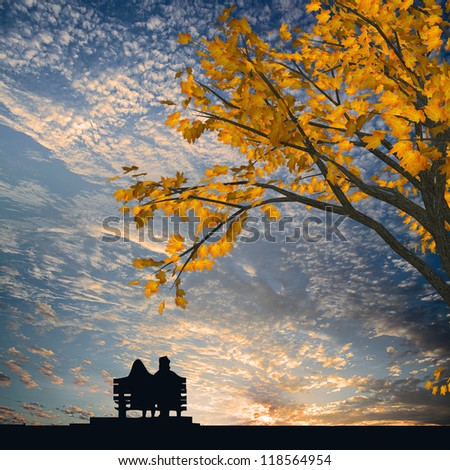Man and woman sitting on the chair - stock photo