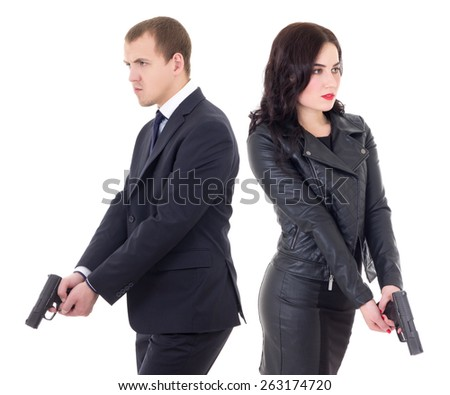 man and woman special agents with guns isolated on white background - stock photo