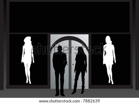 man and woman standing outside nightclub at night
