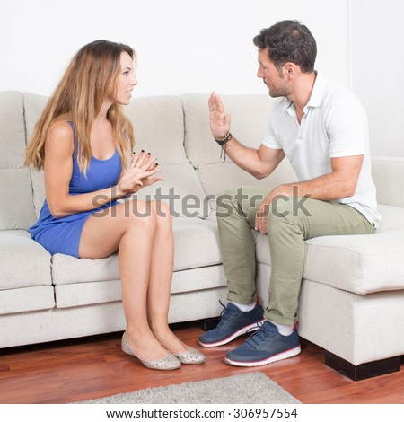 man and woman talking about infidelity