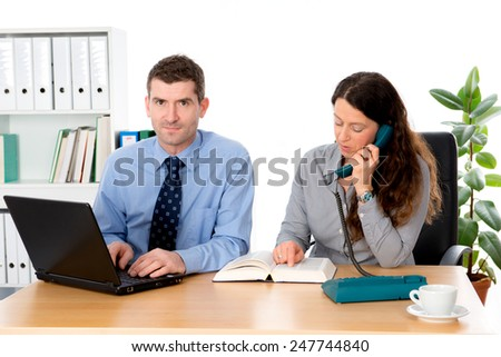 man and woman together in the office  - stock photo