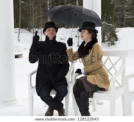 Man and woman waiting rain at winter day