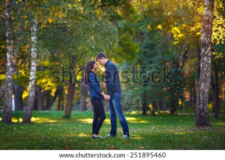man and woman walking in the park. - stock photo