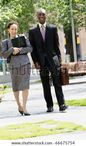 Man and woman walking together - stock photo