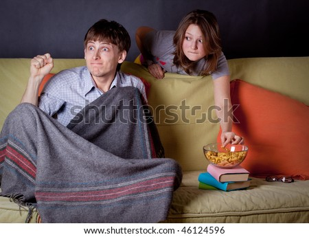 man and woman watching sport match - stock photo