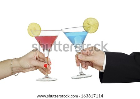 man and woman with cocktails toasting glasses - stock photo