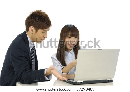 Man and woman with computer