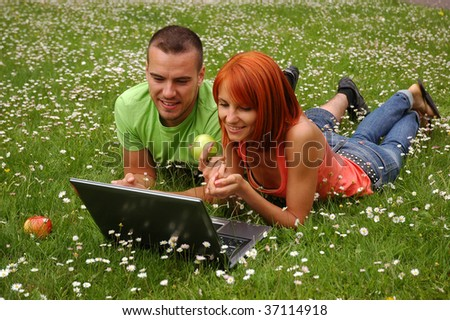man and woman with computer and apple - stock photo