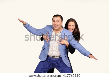 Man and woman with funny faces isolated over white background - stock photo
