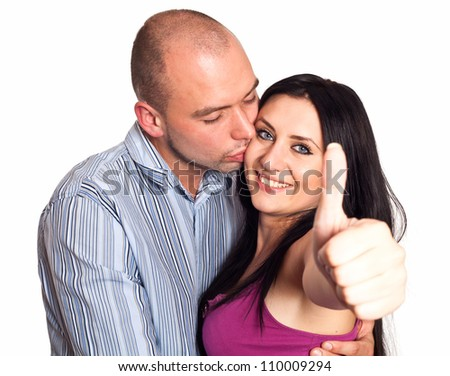 Man and woman with thumbs-up gesture isolated on white - stock photo