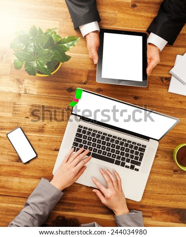 Man and woman working on digital devices. Shot from above view - stock photo