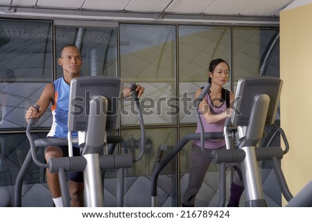 Man and woman working out in the gym. - stock photo