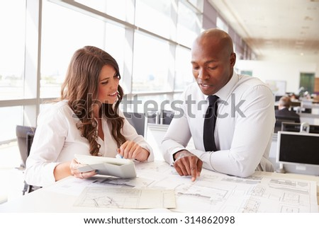Man and woman working together in an architect?s office - stock photo