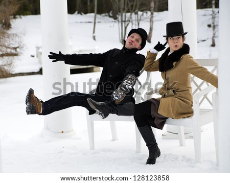 Man and woman worming at balcony white chairs
