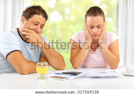 Man and woman worried about their financial state - stock photo