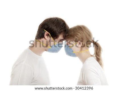 Man and woman 20-35 years  in blue face masks  with heads together  against white background - stock photo