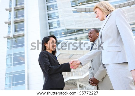 Man and Woman young and  diverse business team handshake at office building