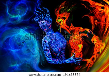 Man and women faces and bodies with fluorescent body art. Black background. - stock photo