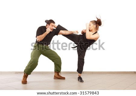 Man and young woman fighting together
