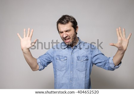 Man angry on gray background isolated - stock photo