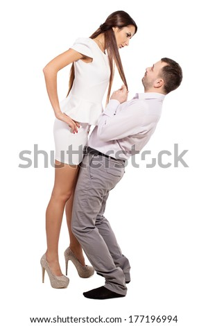 Man apologizes to his wife. Family boss berates his husband. Interaction between two people. Woman director and a man slave. Relationship man and woman. Isolated. Woman dominates man in the family. - stock photo