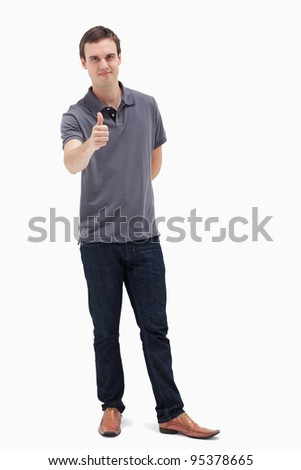 Man approving with his thumb up against white background
