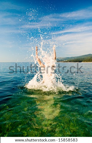 man are jumping from ocean water