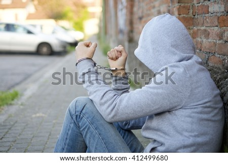 man arrested in handcuffs - stock photo