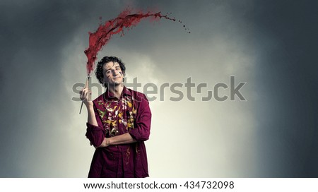 Man artist painting with brush - stock photo