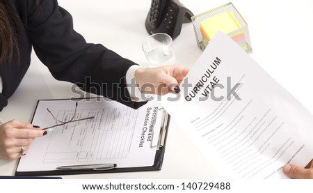 man at a a job interview with  interviewer, giving her his resume - stock photo