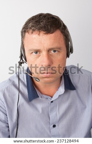 Man at call center - stock photo