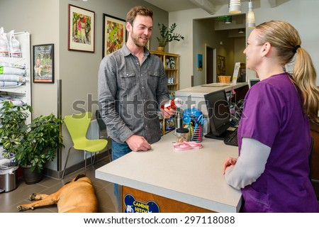 Man at counter in vet office
