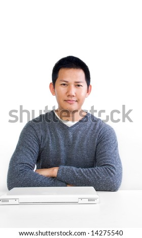 Man at his desk with laptop - stock photo