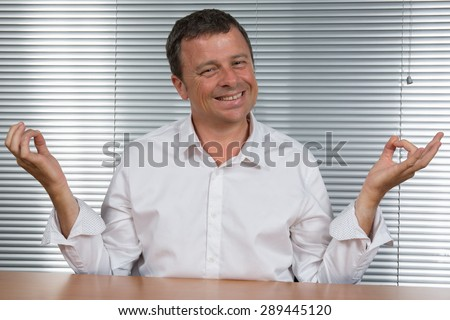 Man at office Tries  to meditate to relax