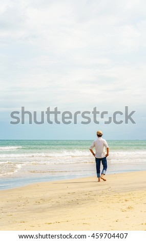 Man at the China Beach in Danang in Vietnam. It is also called Non Nuoc Beach. South China Sea on the background.