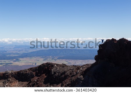Man at the crater edge of Mount Ngauruhoe - stock photo