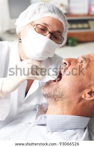 Man at the dentist - stock photo
