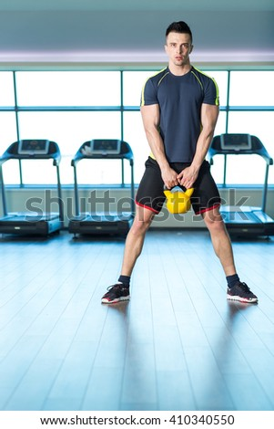 Man at the gym exercising - stock photo