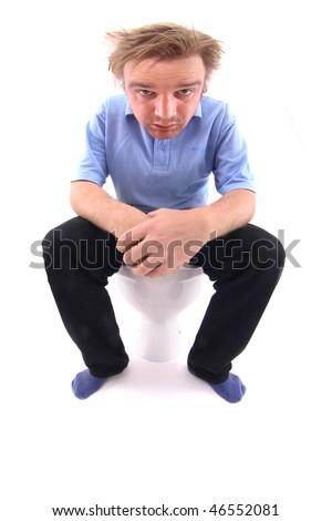 man at WC - stock photo