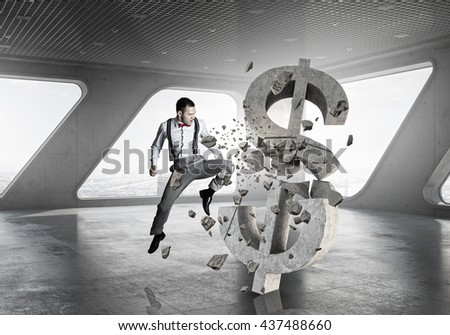 Man attacking dollar symbol