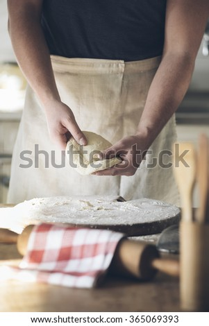 Man baking bread in kitchen.