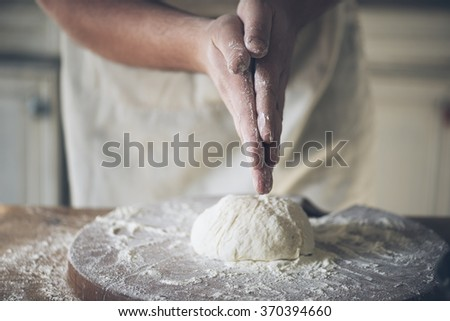 Man baking bread in the kitchen.