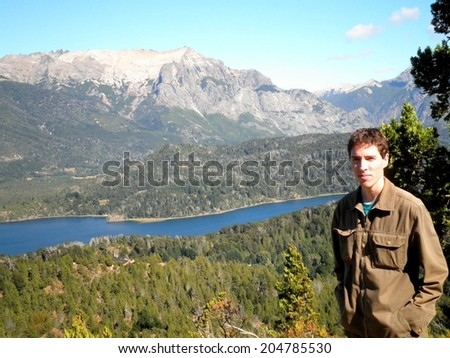 Man Bariloche forest landscape Patagonia mountains river. - stock photo