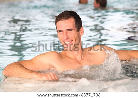 Man bathing in jacuzzi of spa center - stock photo