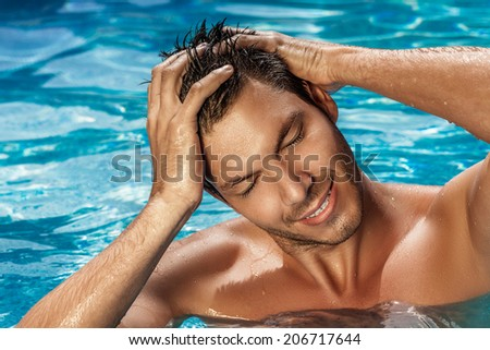 man bathing washing swimming in tropical spa resort - stock photo